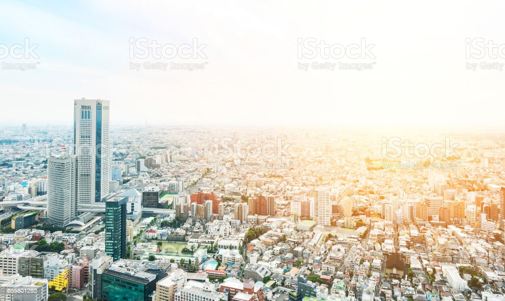 panoramic modern city skyline bird eye aerial view with mode gakuen cocoon tower under dramatic sun and morning blue cloudy sky in Tokyo, Japan stock photo
