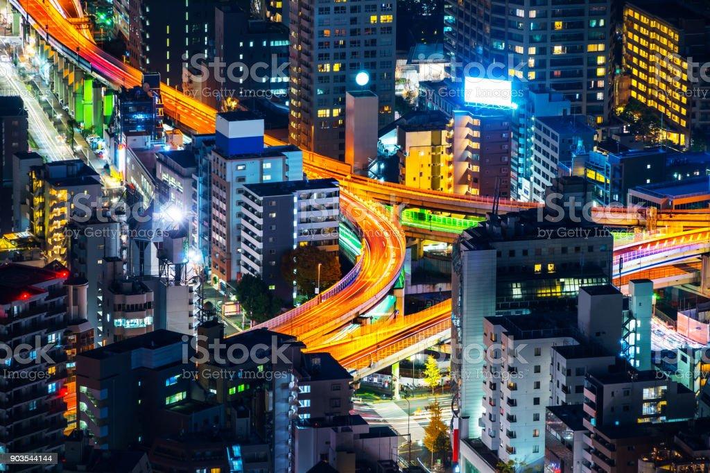 panoramic modern city skyline of Tokyo Metropolitan Expressway junction at night stock photo
