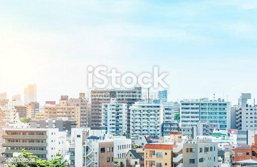1001353450 istock photo panoramic modern city urban skyline bird eye aerial view under sun & blue sky in Tokyo, Japan 1001338526
