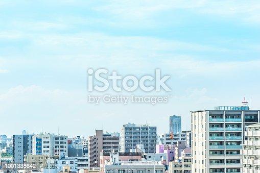 1001353450 istock photo panoramic modern city urban skyline bird eye aerial view under sun & blue sky in Tokyo, Japan 1001338642