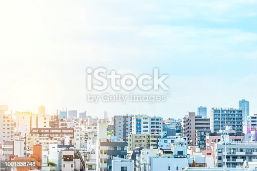 1001353450 istock photo panoramic modern city urban skyline bird eye aerial view under sun & blue sky in Tokyo, Japan 1001338748