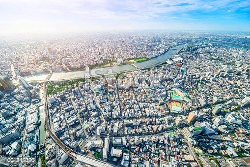 1001353450 istock photo panoramic modern city urban skyline bird eye aerial view under sun & blue sky in Tokyo, Japan 1001342320