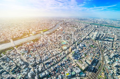 1001353450 istock photo panoramic modern city urban skyline bird eye aerial view under sun & blue sky in Tokyo, Japan 1001342596