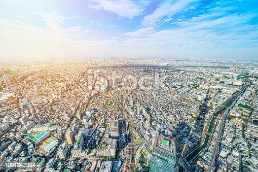 1001353450 istock photo panoramic modern city urban skyline bird eye aerial view under sun & blue sky in Tokyo, Japan 1001342994