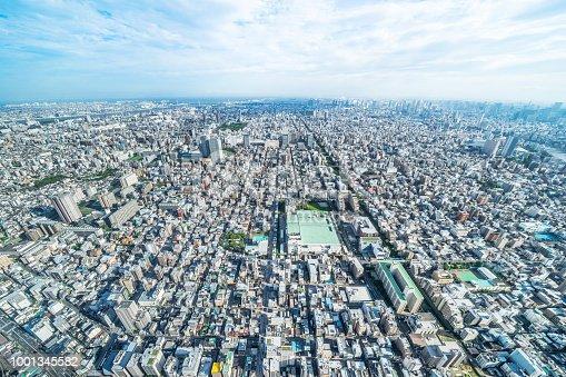 1001353450 istock photo panoramic modern city urban skyline bird eye aerial view under sun & blue sky in Tokyo, Japan 1001345582