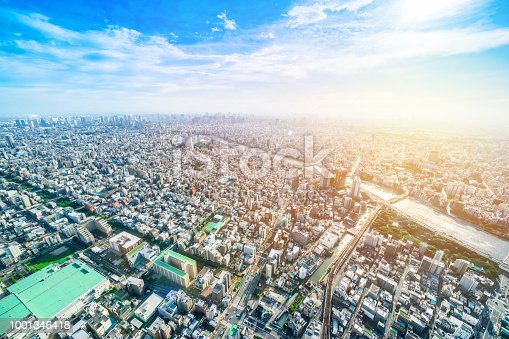 1001353450 istock photo panoramic modern city urban skyline bird eye aerial view under sun & blue sky in Tokyo, Japan 1001346418