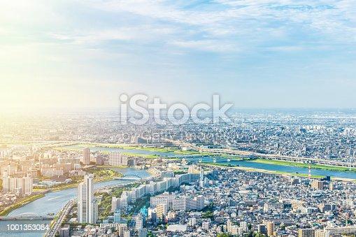 1001353450 istock photo panoramic modern city urban skyline bird eye aerial view under sun & blue sky in Tokyo, Japan 1001353084
