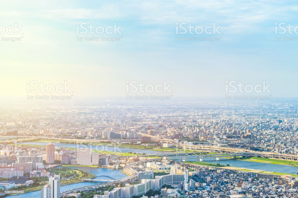 panoramic modern city urban skyline bird eye aerial view under sun & blue sky in Tokyo, Japan