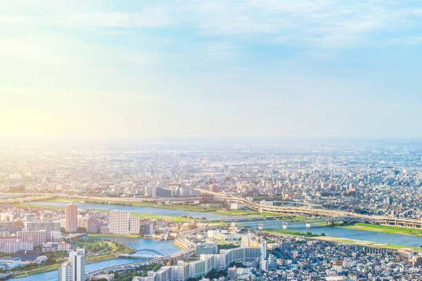 panoramic modern city urban skyline bird eye aerial view under sun & blue sky in Tokyo, Japan - foto stock