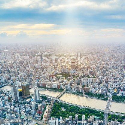 1001353450 istock photo panoramic modern city urban skyline bird eye aerial view under sun & blue sky in Tokyo, Japan 1001353706