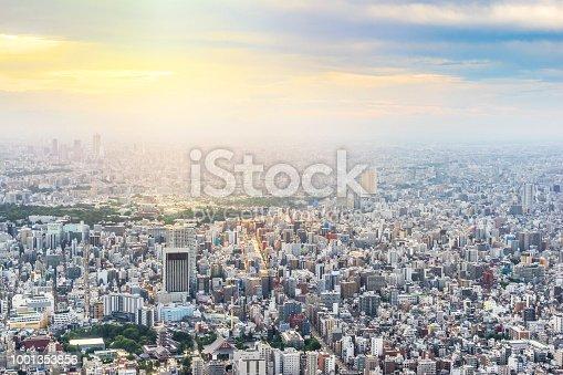 1001353450 istock photo panoramic modern city urban skyline bird eye aerial view under sun & blue sky in Tokyo, Japan 1001353856