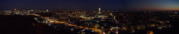Panoramic Moonrise over the Moosach district of Munich, Germany stock photo