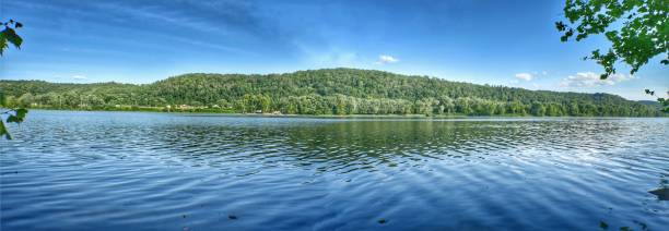 Panoramic mountain trees, sisterville Ohio river Panoramic riverbank mountain trees blue green water reflection appalachia stock pictures, royalty-free photos & images