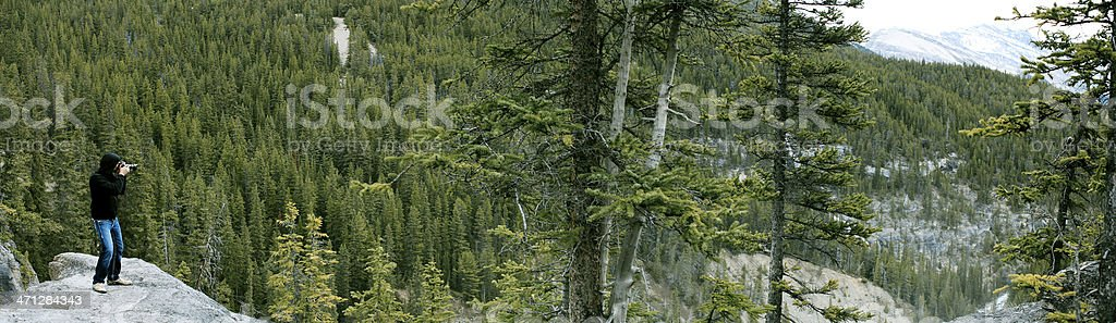 Panoramic of a Photographer shooting a Landscape royalty-free stock photo