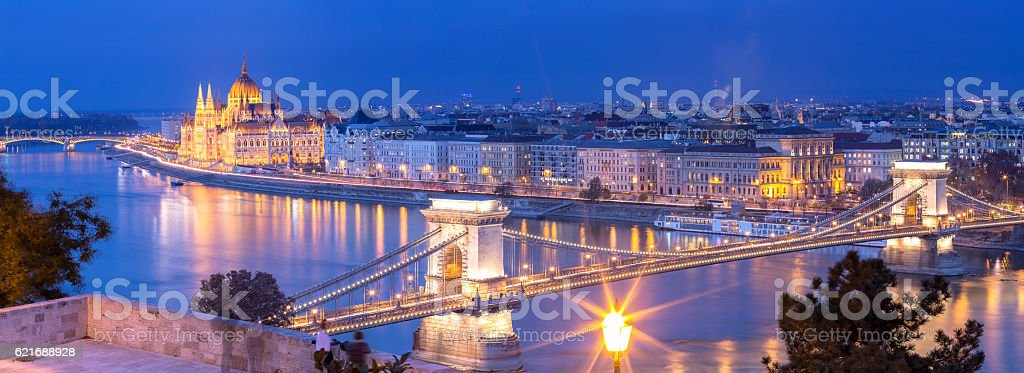 Panoramic of Chain Bridge and Parliament in Budapest at dusk stock photo