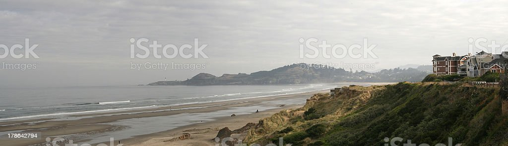 Panoramic of coast, lighthouse, and buildings stock photo
