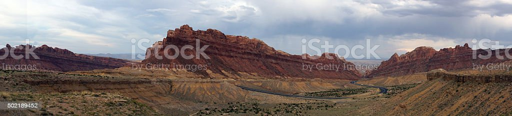 Panoramic of Road winds through Spotted Wolf Canyon stock photo