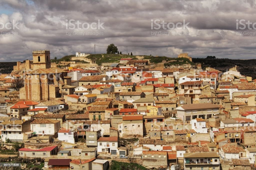 Panoramic of the village of Jorquera on the mountain and the river cabriel surrounding it stock photo
