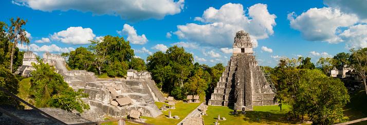 istock Panoramic of Tikal pyramids Gran Jaguar in Peten, Guatemala. Mayan culture. 969039778
