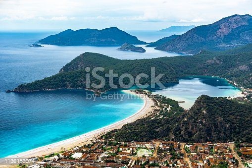 istock Panoramic Oludeniz Bay view in Fethiye Town. Amazing landscape from Lycian way. Travel destination. Summer and holiday concept. Blue Lagoon. 1136153074