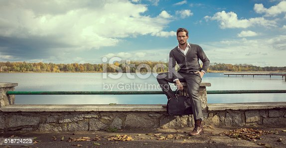 istock Panoramic photo of handsome man on the lake 518724223