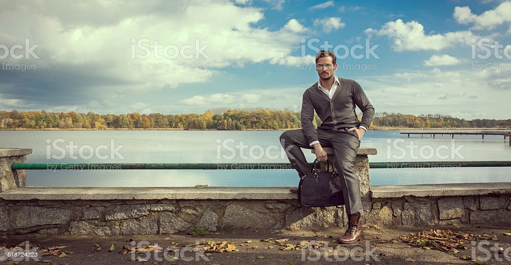 Panoramic photo of handsome man on the lake stock photo