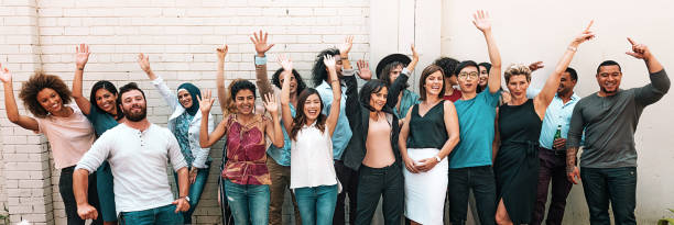 Panoramic photo of multi ethnic group of adults stock photo