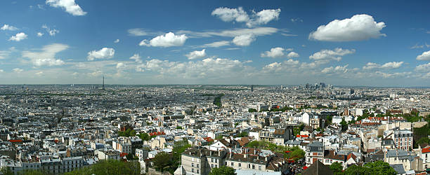 Panoramic photo of Paris, France Aerial panoramic image of Paris, taken from the tower of the Sacre Coeur ile de france stock pictures, royalty-free photos & images