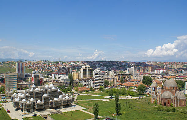 Panoramic photo of Prishtina Kosovo Prishtina, Kosovo: Skyline of the Kosovar capital on a sunny summer day. The National Library and an Othodox church can be seen in the foreground. davelongmedia stock pictures, royalty-free photos & images