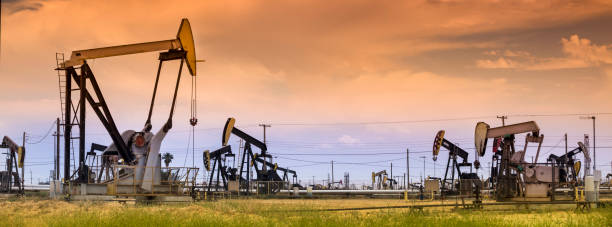 Panoramic pumpjack lifts oil from a well in California stock photo