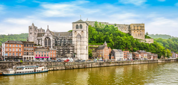 Panoramic river landscape view of Huy, Wallonia, Belgium. Bright and colorful wide angle view of river meuse and fort of Huy in Belgium. lulik stock pictures, royalty-free photos & images