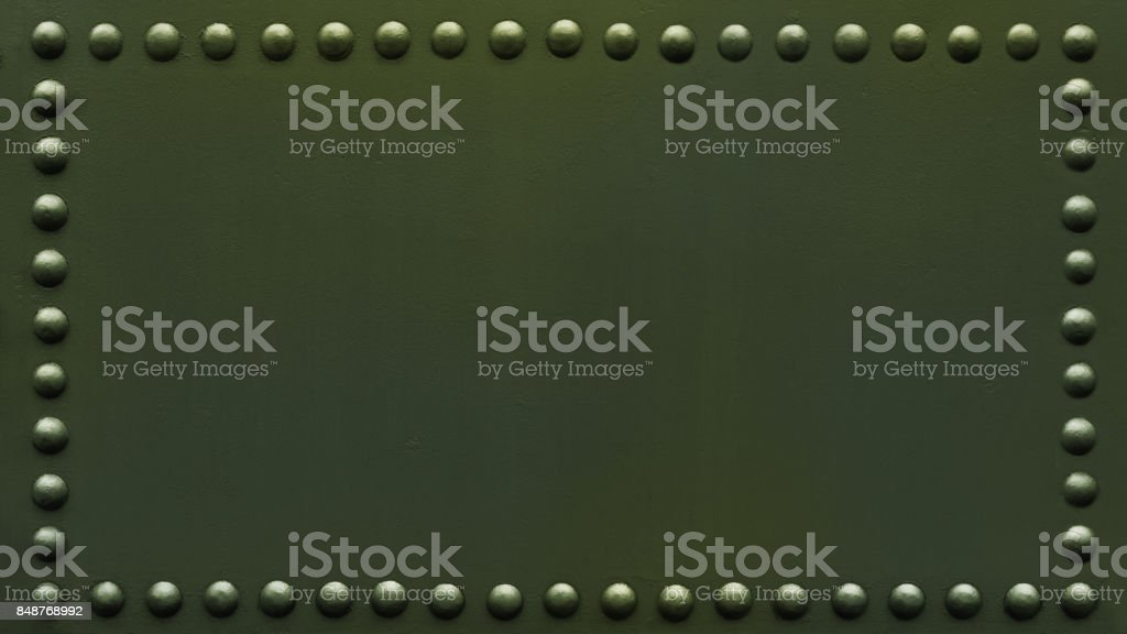 panoramic riveted military plate stock photo