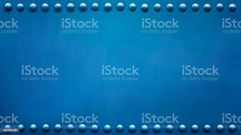 panoramic riveted plate blue stock photo
