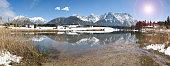Panoramic scene in Bavaria with Karwendel mountains mirroring in lake