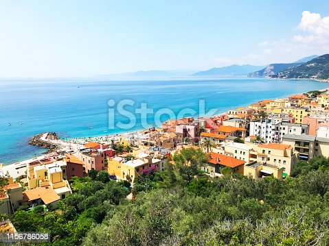 istock Panoramic sea coast view from the top of the mountain. Sea landscape with a small town and pier 1156786058