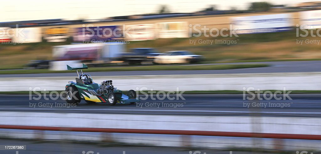 A panoramic selective focus of a fast dragster. stock photo