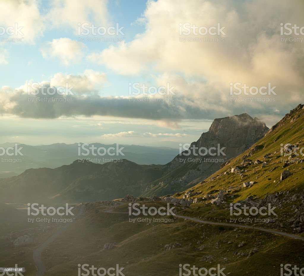 Panoramic shoot of morning fog over winding road. XXXXL image. stock photo