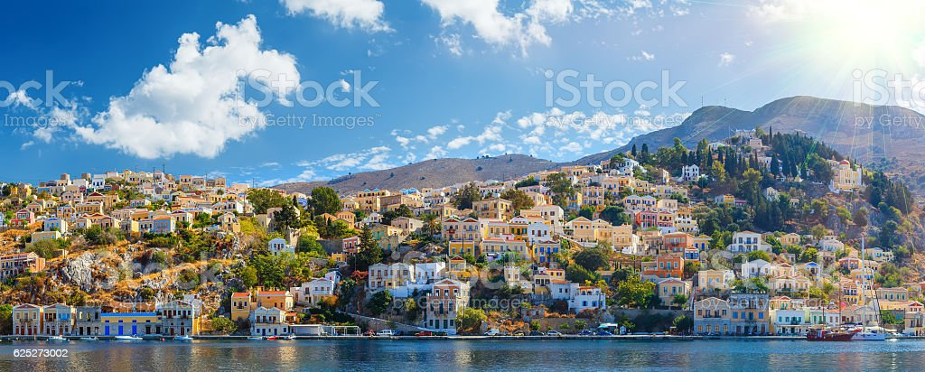 Panoramic shot Harbour Symi Greece with traditional fishing boat stock photo