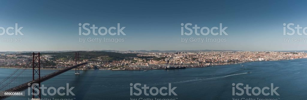 Panoramic shot of 25th de Abril bridge and Lisbon stock photo