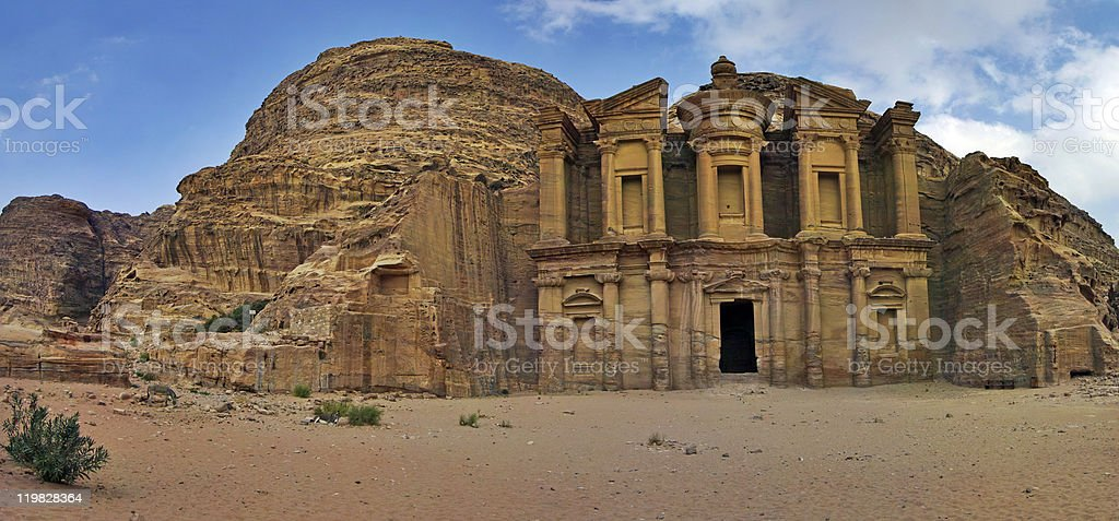 Panoramic shot of the Monastery Ad-Deir in Petra, Jordan. stock photo