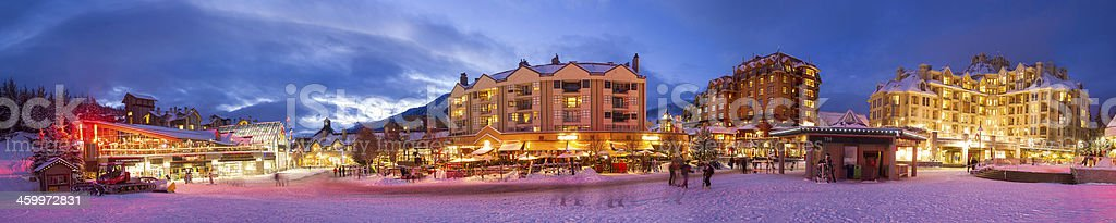 Panoramic shot of Whistler Village on a winter evening stock photo