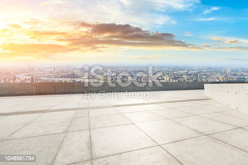 693903950istockphoto Panoramic skyline and buildings with empty city square floor 1048561734