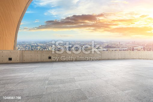 693903950istockphoto Panoramic skyline and buildings with empty city square floor 1048561766