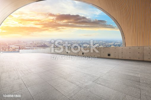 693903950istockphoto Panoramic skyline and buildings with empty city square floor 1048561800