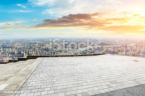 693903950istockphoto Panoramic skyline and buildings with empty city square floor 1048561834