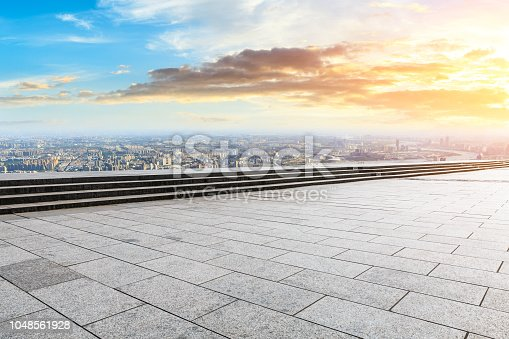 693903950istockphoto Panoramic skyline and buildings with empty city square floor 1048561928