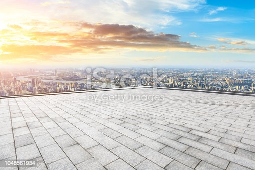 693903950istockphoto Panoramic skyline and buildings with empty city square floor 1048561934
