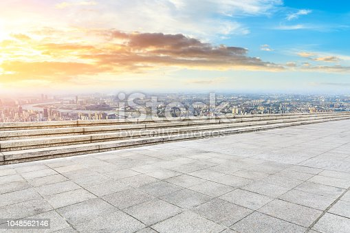 693903950istockphoto Panoramic skyline and buildings with empty city square floor 1048562146