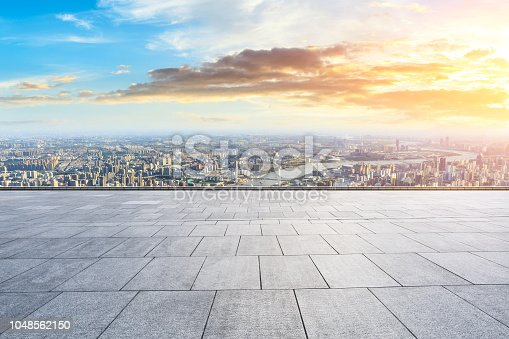 693903950istockphoto Panoramic skyline and buildings with empty city square floor 1048562150