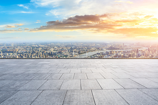693903950 istock photo Panoramic skyline and buildings with empty city square floor 1048562150